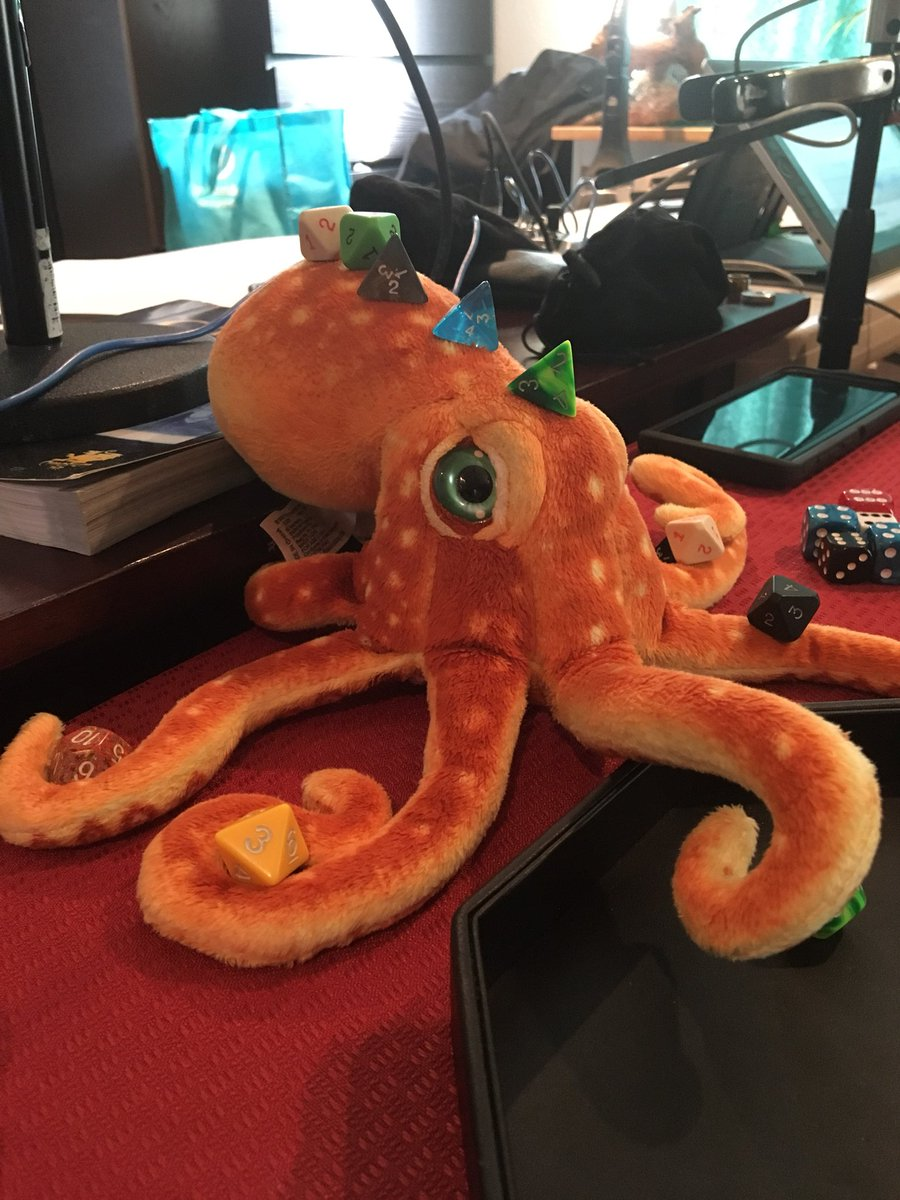 Dice on an octopus.... Corndog stays very still.....