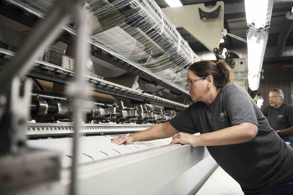 Fairystone Fabrics employee working with factory equipment