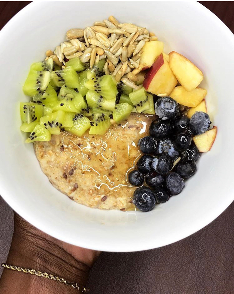 Breakfast - Here is  some oatmeal with flax seeds, apple, kiwi, frozen blueberries, honey, and roasted sunflower seeds!