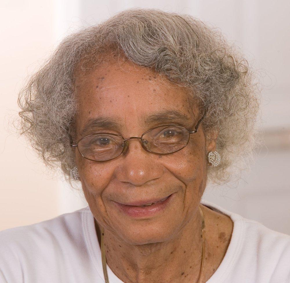 Elder woman smiles at camera