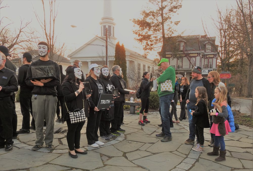 Anonymous for the Voiceless - Kingston, NY Chapter holding a Cube of Truth in Woodstock, NY