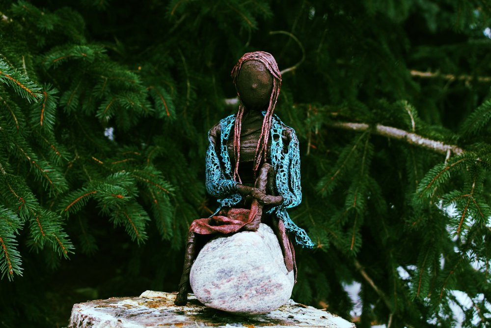 seated figure on rock.JPG