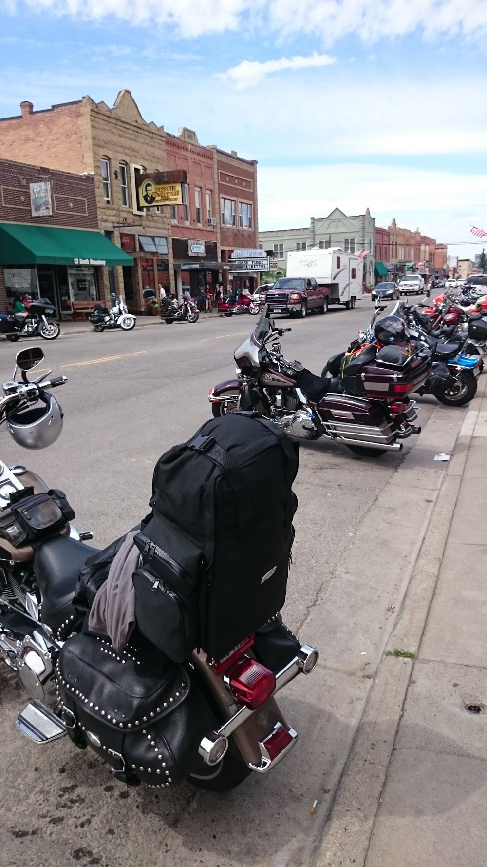 Things to expect - Main street of downtown is filled with nothing but a long line of parked bikes for some great spectating. Have a car? Good luck, try finding a side street to park at instead. This weekend is all about the bikes. Harleys, tricycles, custom paint jobs, shining chrome, classic bikes and the weird fill downtown. Showing off your own ride and comparing bikes with others is good fun and might even get you some new riding buddies. If you are likely staying out late, make sure to get a sober drive home or walk back to your lodging. The Corner Stone is in walking distance! Check to see if we are available.  Shops and vendors will also be found all throughout downtown. Need new leather? No problem, outfitters will have you covered, literally. One might say leather is the official dress code for the Beartooth Rally. Poker runs, live music with dances and even a golf tournament can be things to expect.  The iron horse rodeo itself is a wild time full of fun and crazy motorcycle iron horse competitions. Barrel racing, a slow race and a sausage eating contest are just a few of the possible events at the rodeo. Things are changed up every year to keep things interesting. The only thing you know you will get for sure is a good time. Want to join the Iron Horse Rodeo? Try signing up, or watch from the crowd.