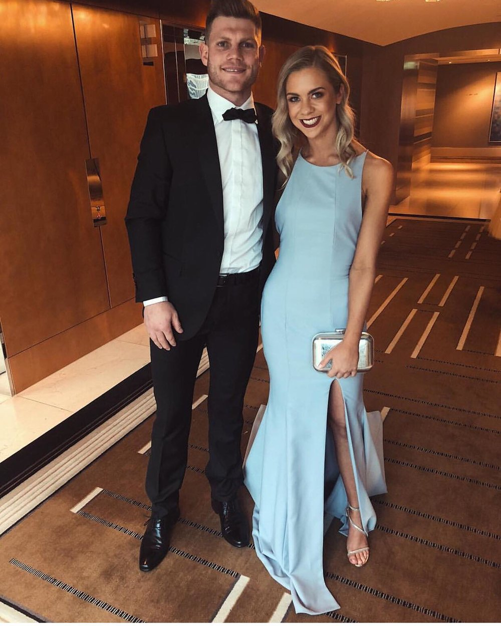 Brownlow 2018 - Taylor Adams with partner Ellie Thornycroft wearing bespoke gown by Meg Parry Studio