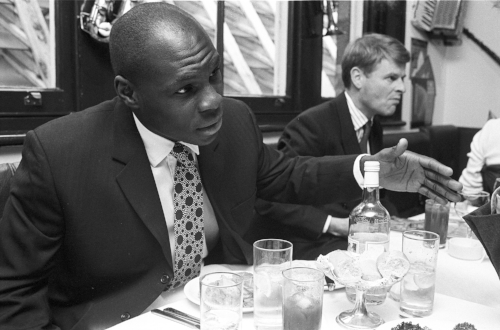 Nigeran-born Adedayo Adebayo played for Bath 66 times and won 6 caps for England on the wing. Seen here cutting a deal with a business colleague over lunch – he worked for the family business back then.