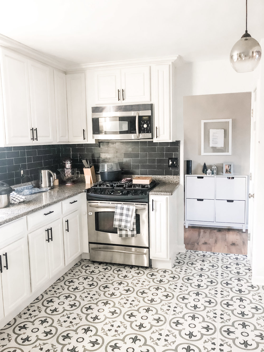 Finished kitchen! So glad I went with the black and white colors earlier this fall when I repainted the cabinets and installed the black backsplash. The patterned tile really pulls everything together.