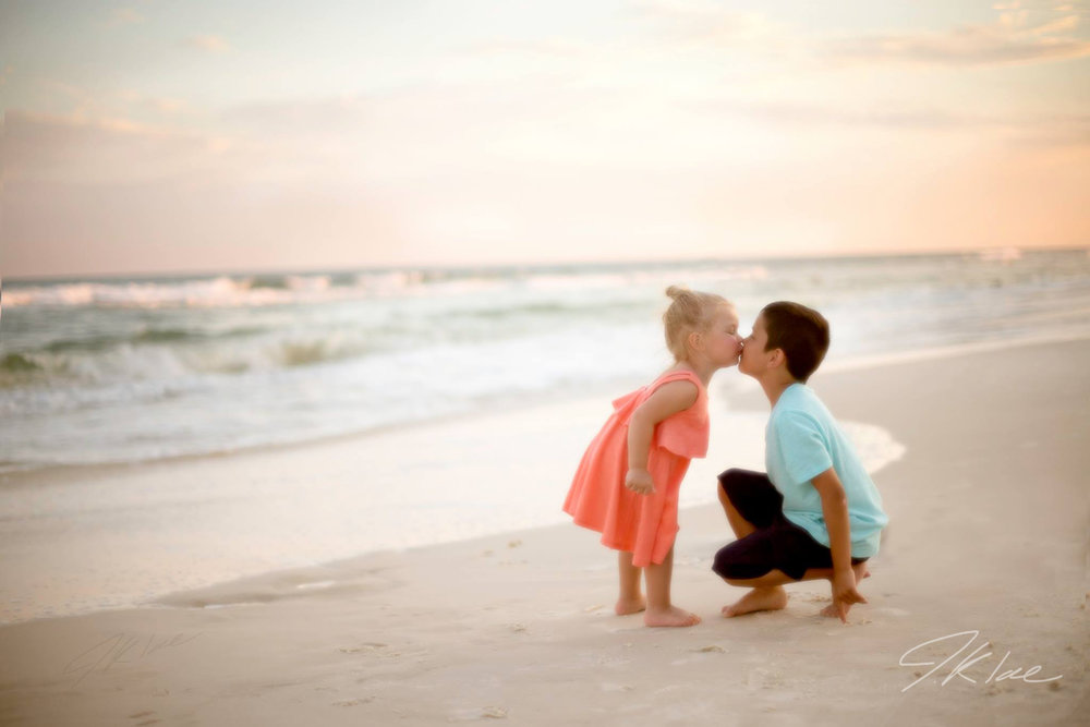 Kids Photo Session of Brother and Sister Kiss on the beach in Pensacola Florida