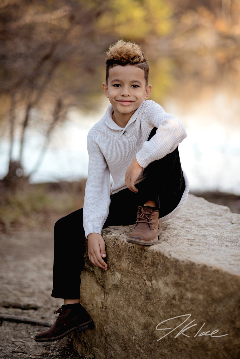 Portrait of a Boy by the pond at Arbor Hills Nature preserve in Plano Texas