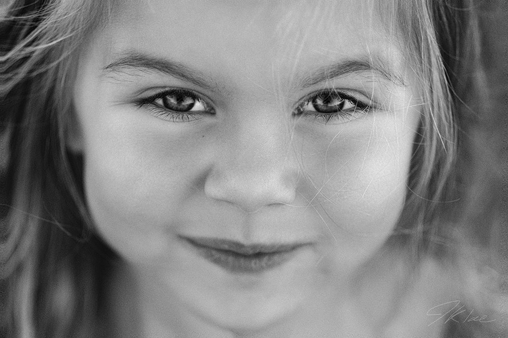 Black and White Child Portrait of girl smirking In McKinney Texas