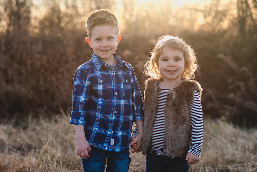 Toddler Photoshoot with Brother and Sister holding hands during sunset in McKinney Texas