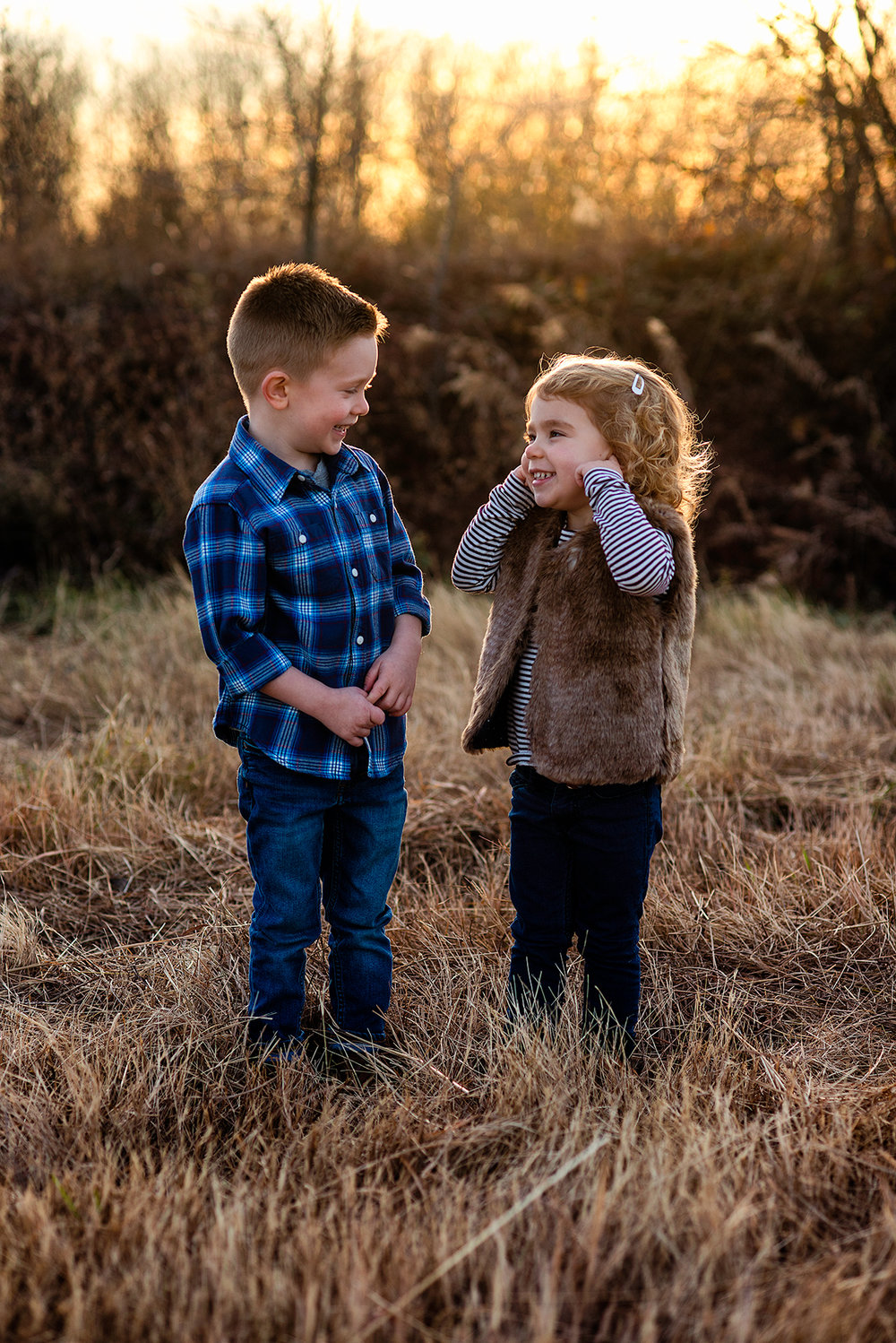 McKinney Texas Toddler Photoshoot with Brother and Sister playing in field during sunset