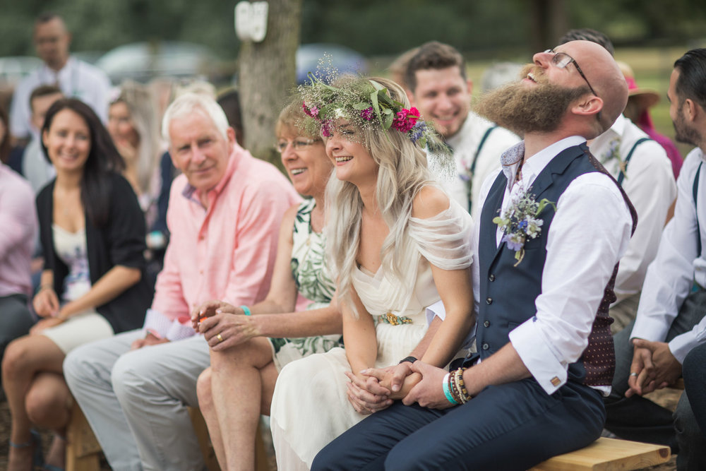 Katy and Paul giggling their way through their humanist wedding ceremony! Image:  Alexa Clarke Kent