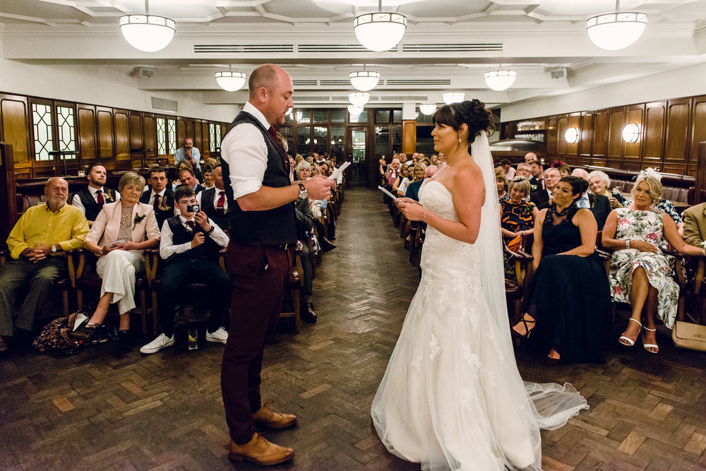 Nicola and Scott exchanging personal vows with each other.