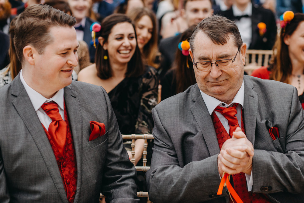 Kirsty's dad taking a short moment with their wedding bands during the Warming of the Rings. Image by Lex Fleming