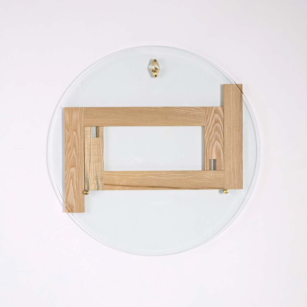 Concept - Designed for smaller living spaces, the flop flip table consists of two identical leg components. One is flipped over and simply slotted together to form the base of the table.The toughened safety glass top has 3 brass pins that lock the table together and also serve as the hook. Simply hang it on your wall when you need that extra space.