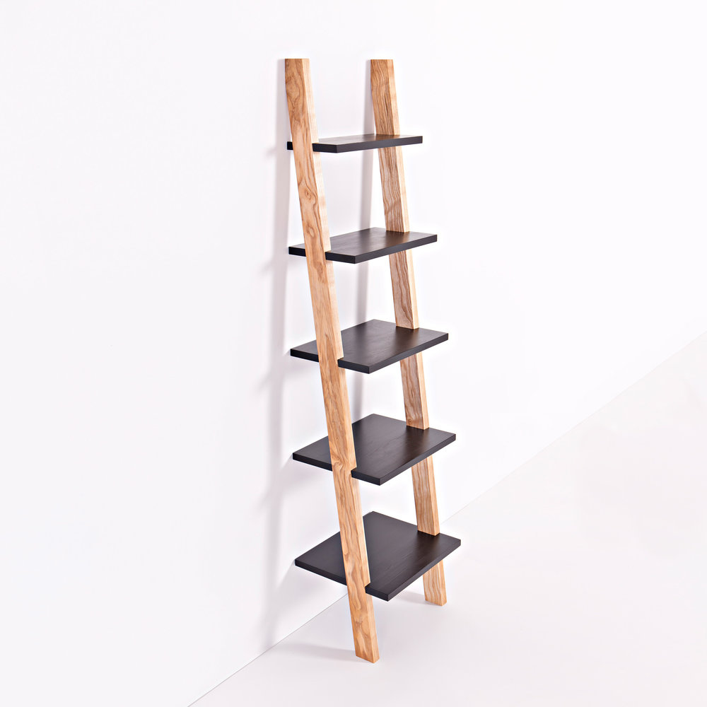 Concept - Elegant, mobile shelving that simply rests against the wall of your favourite space. The contrasting black wax soaks into the Finnish pine grain to highlight the beauty between the summer and winter growth.