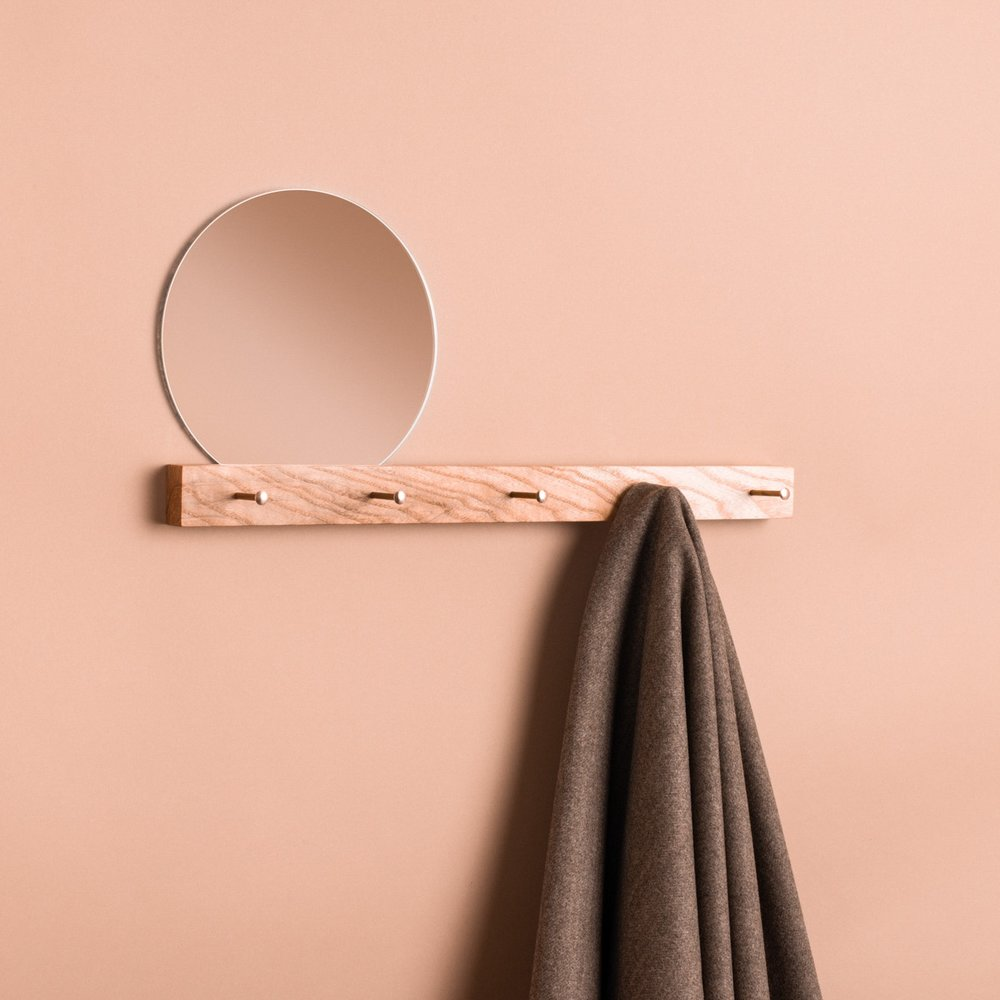 Concept - These simple, elegant hangers are perfect for hanging coats and cleverly combine with a mirror to check yourself on the way out the door.