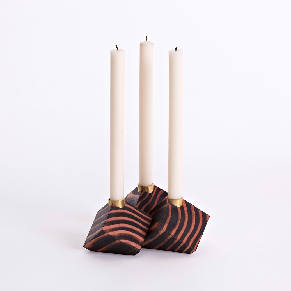 Materials - The candle cubes are handmade from wild Irish redwood. The redwood is scorched to highlight the beauty between the summer and winter grain. Solid brass is used to hold the candle. Finished with a natural, hand rubbed oil.
