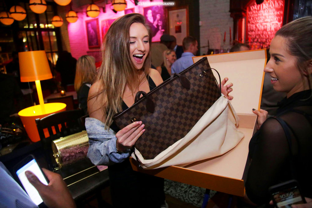 """LADIES NIGHT - Every Wednesday at 7pm. Featuring rotating raffle prizes, drink specials, and our weekly """"Louis Vuitton"""" grand prize."""