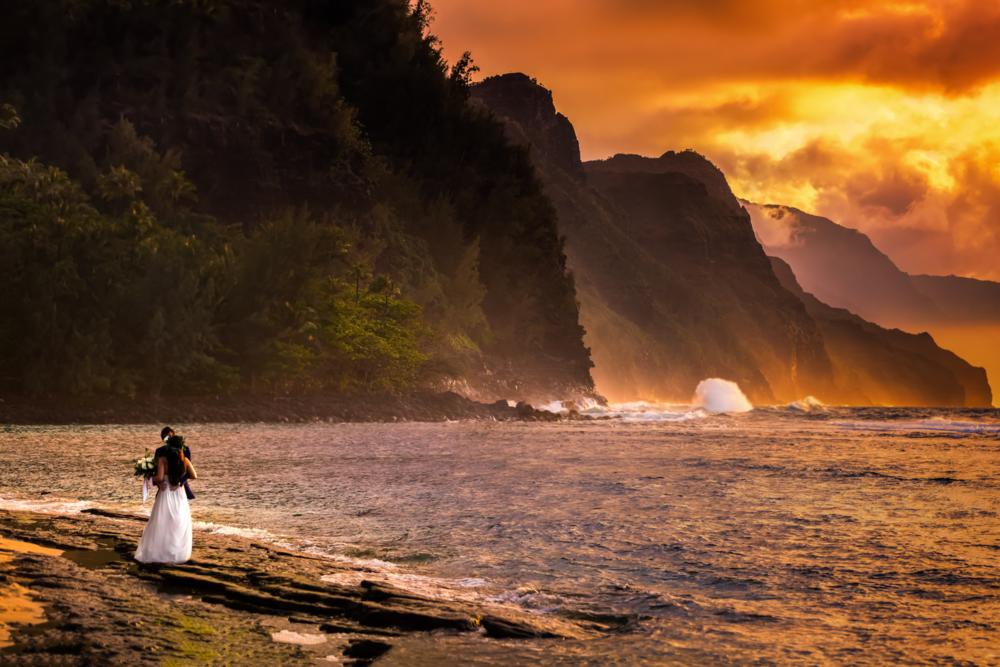 Beautiful Hawaiian Beach At Sunset with Bride and Groom