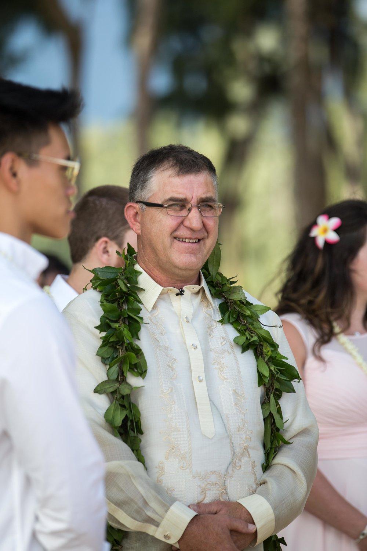 Officiant during a Hawaiian beach wedding.