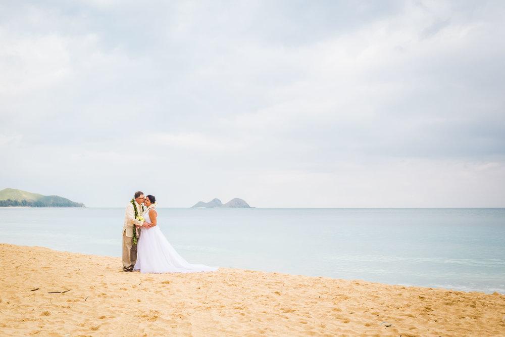 Bride and groom's post wedding bridal shoot on Hawaiian beach.