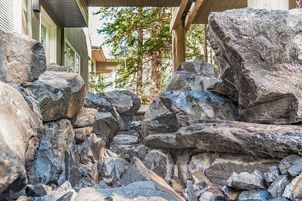 A flagstone patio and a rock fire pit in the Calgary and Banff area