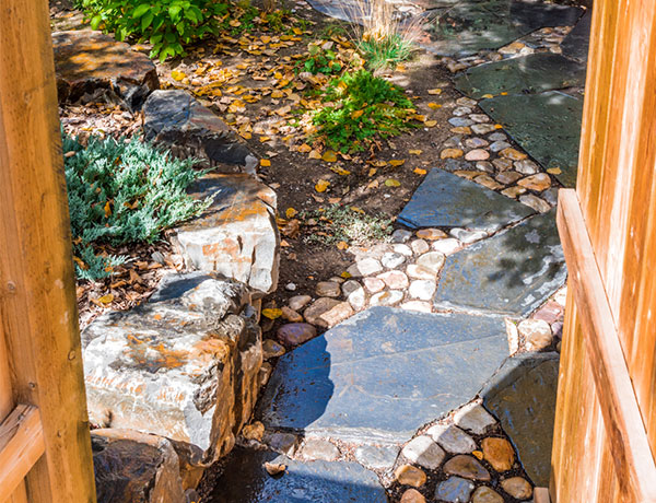 A backyard featuring a stone walkway in the Calgary and Banff area