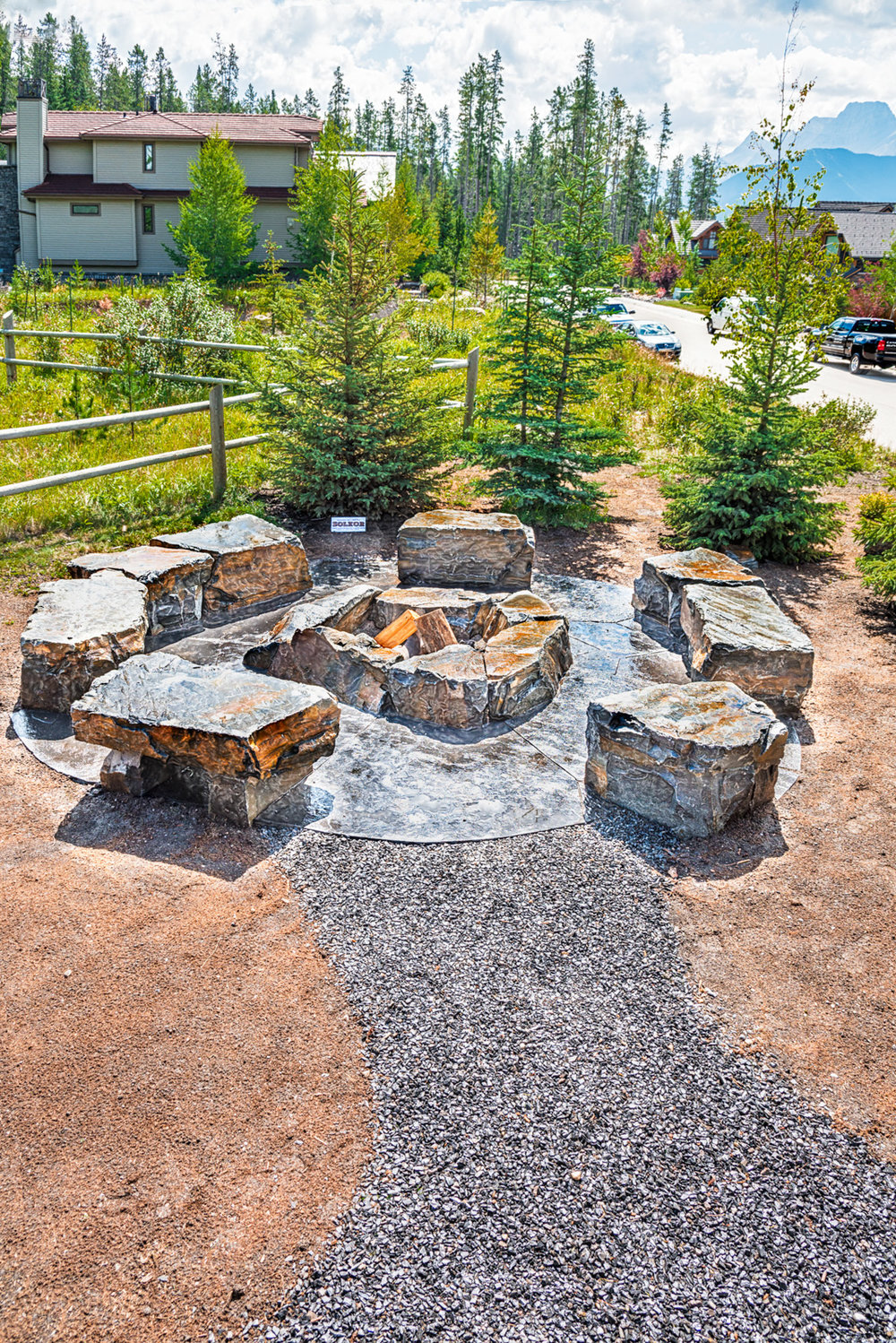 A rock fireplace surrounded by stone benches in the Calgary and Banff area