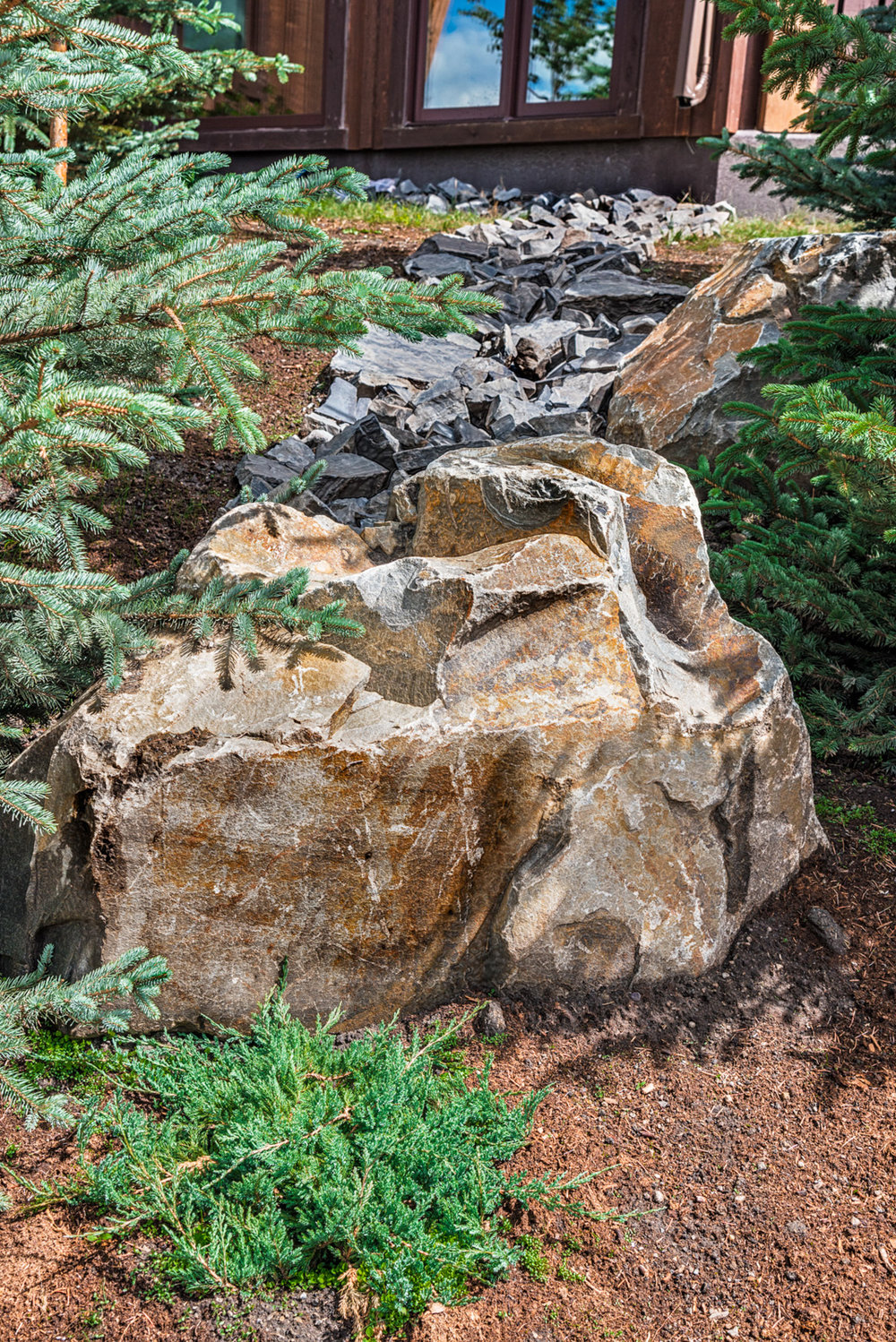 A rock feature in the yard of a home in the Calgary and Banff area