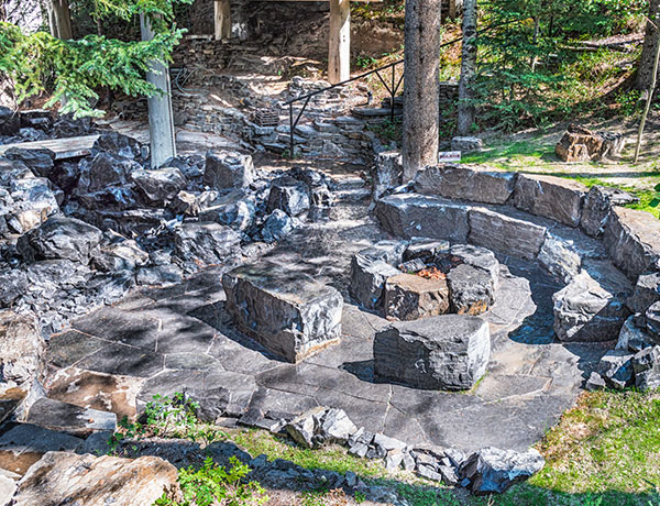 A stone fire pit featuring fire tables and features in the Calgary and Banff area