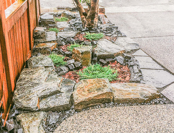 A yard featuring stonework inspired by the Rocky Mountain landscape in the Calgary and Banff area