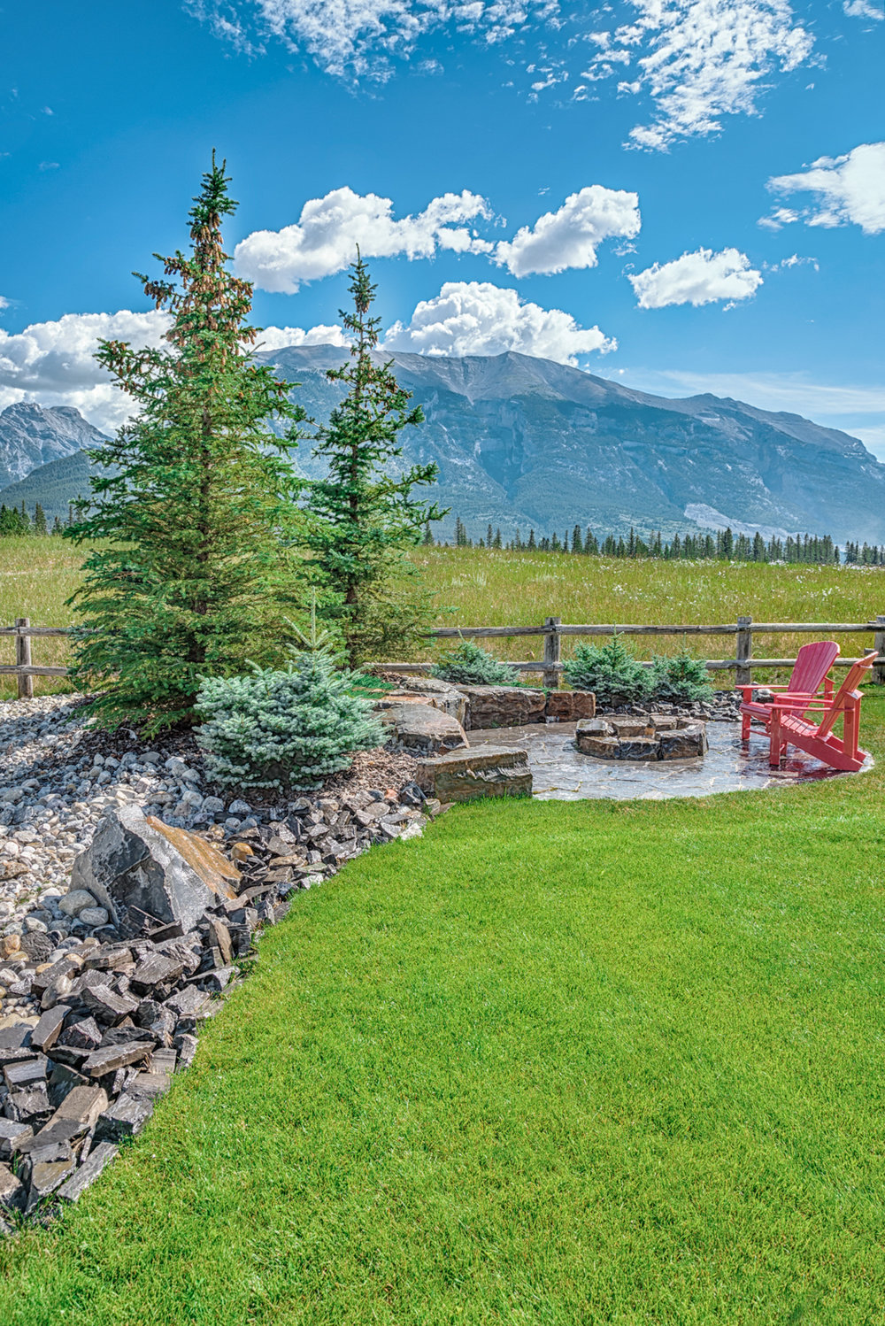 A stone fireplace complete with stone seating and steps in the Calgary and Banff area