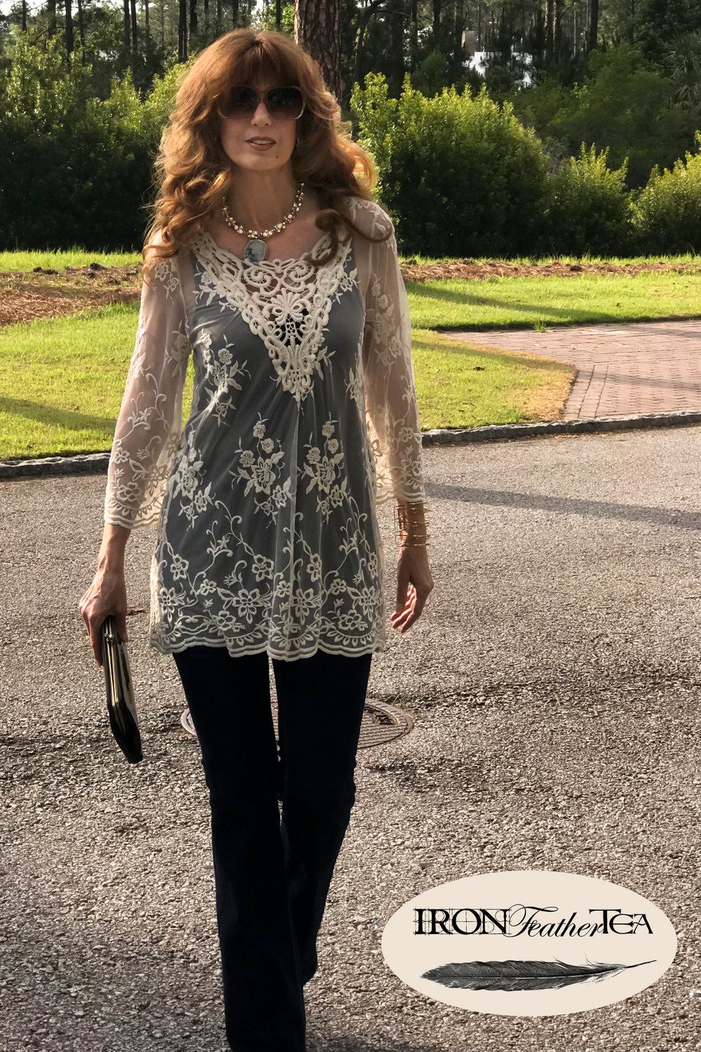 Delicate lace over a black tank top.