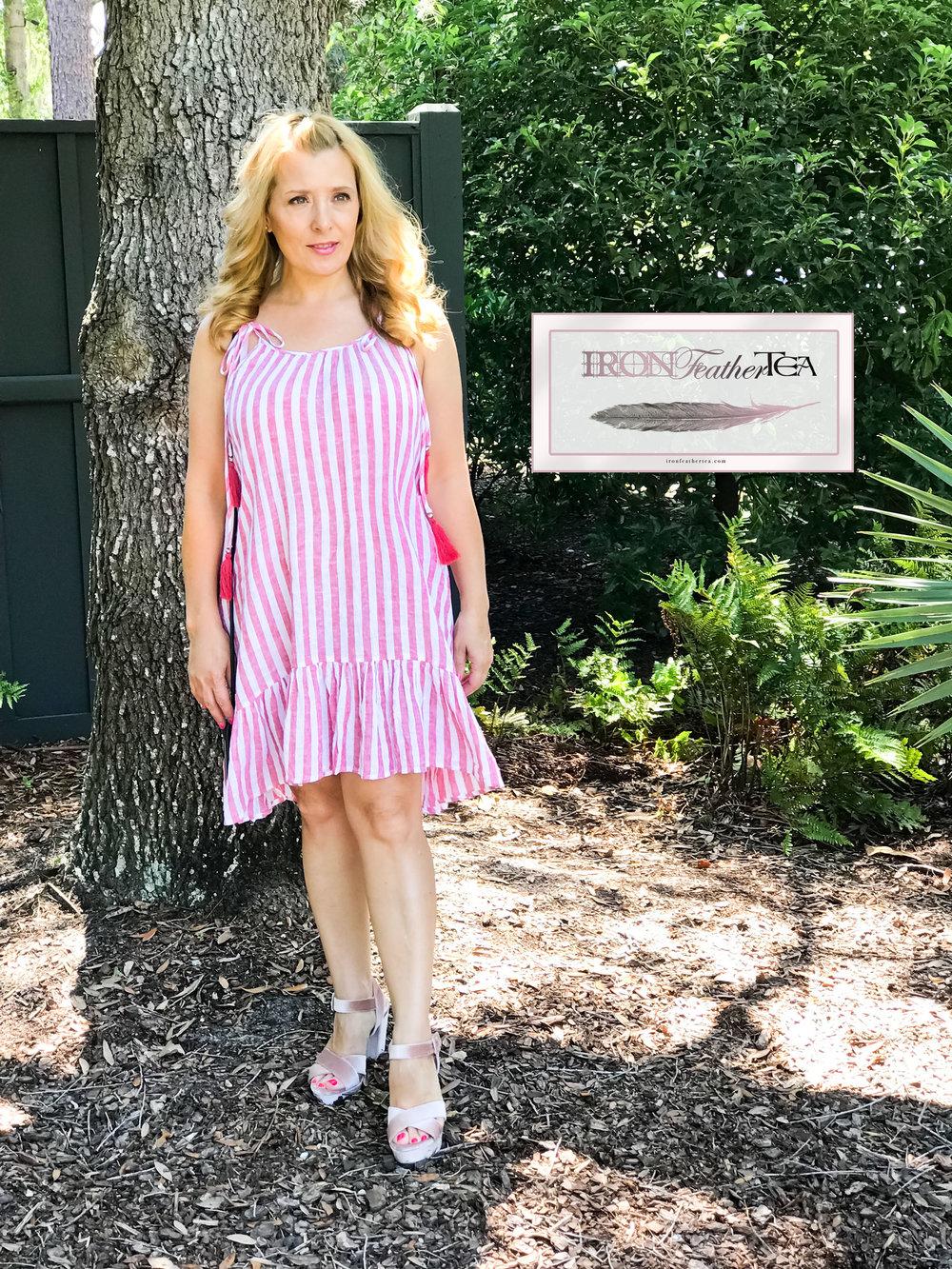 Striped cotton dress and pink velvet platform sandals.