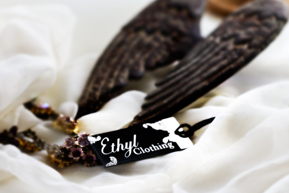 Even the Ethyl Clothing garment tag is gorgeous. And yes, those are IRON Wings in the background. Iron Feather Tea!