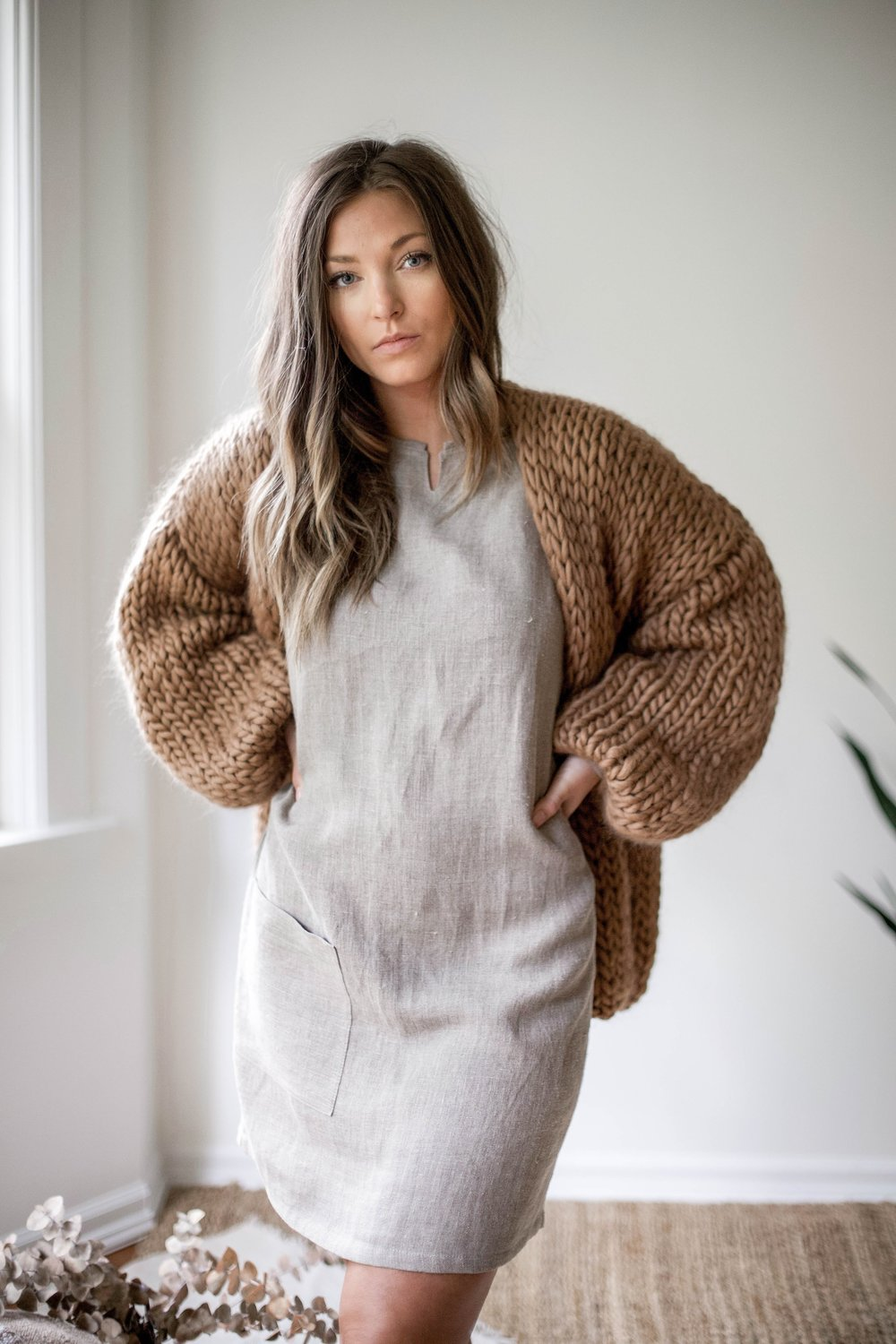 nomi-designs_ali-dress_natural-linen-dress-with-pockets_front_styled-with-oversized-hendik-lou-sweater-details.jpg