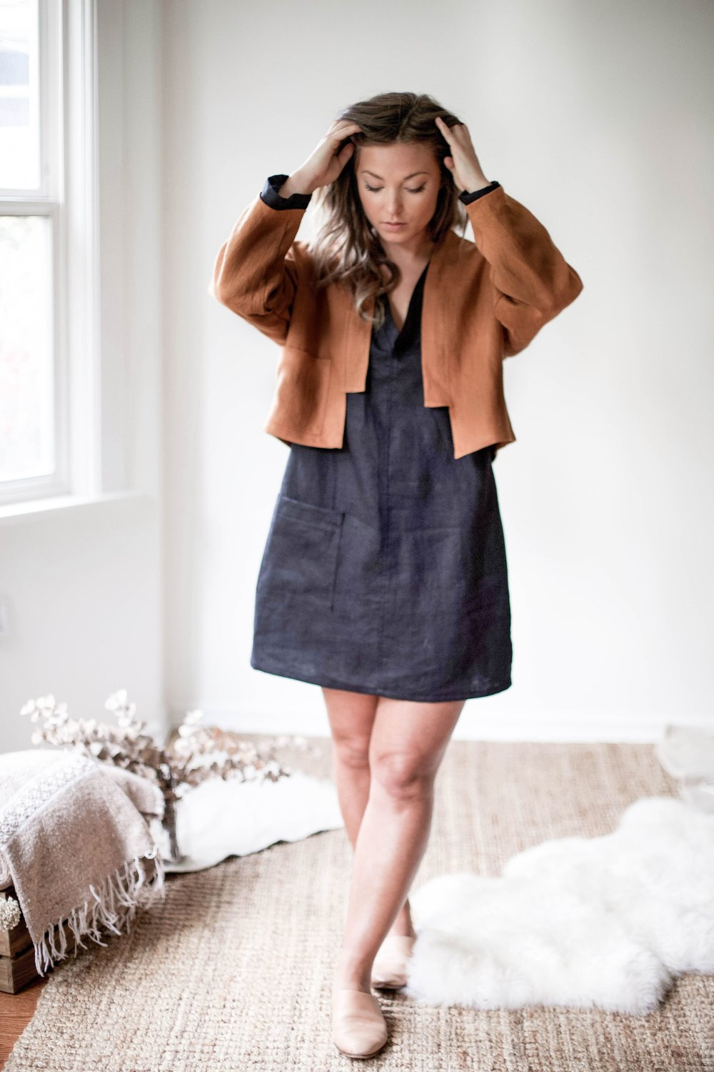 nomi-designs_ann-jacket_rust-colored-natural-linen-jacket_front-paired-with-ali-dress-and-mule-slides.jpg