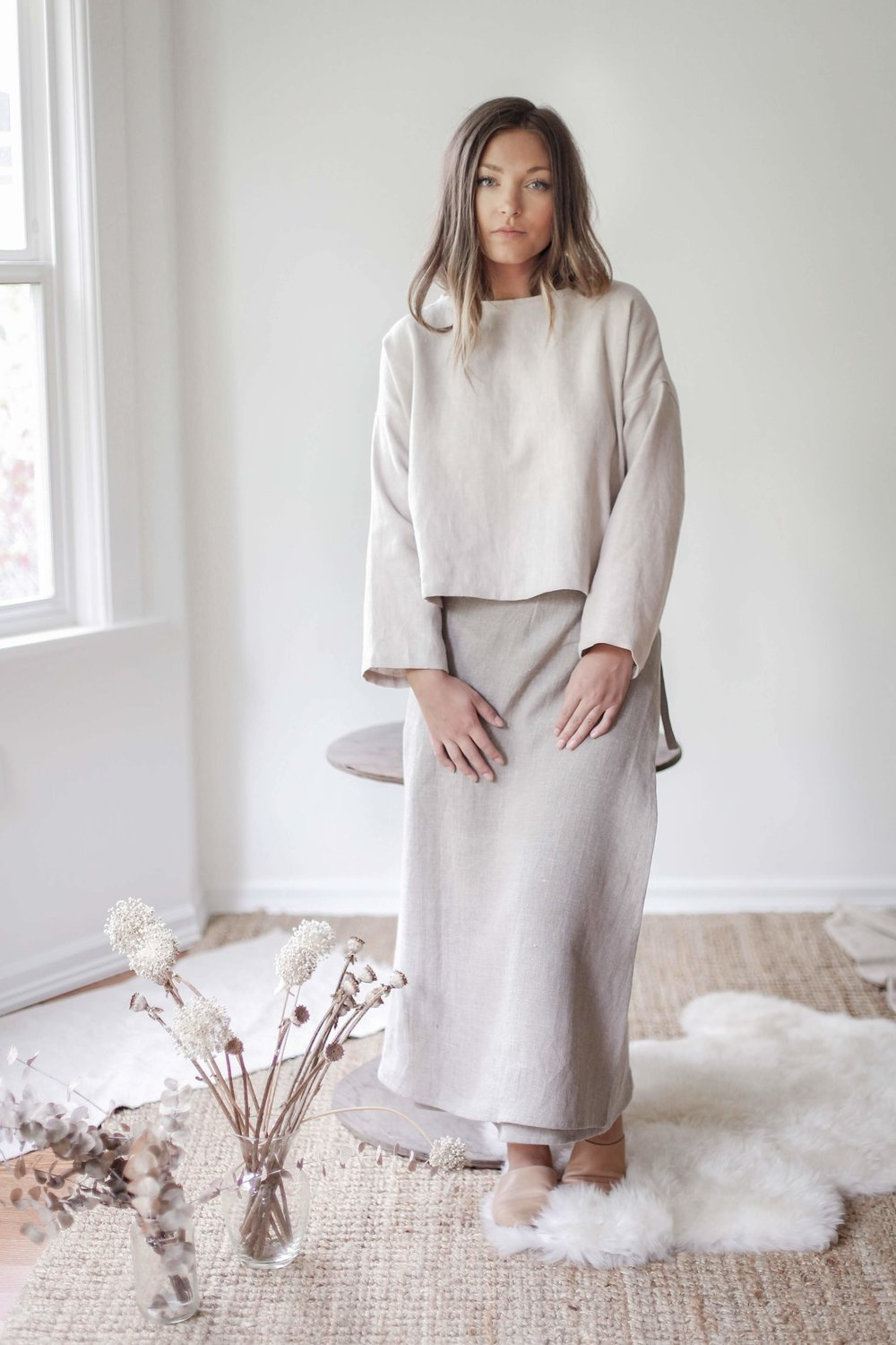 nomi-designs_madison-long-sleeve-top_gleam_natural-linen-top_front-with-wrap-skirt.jpg