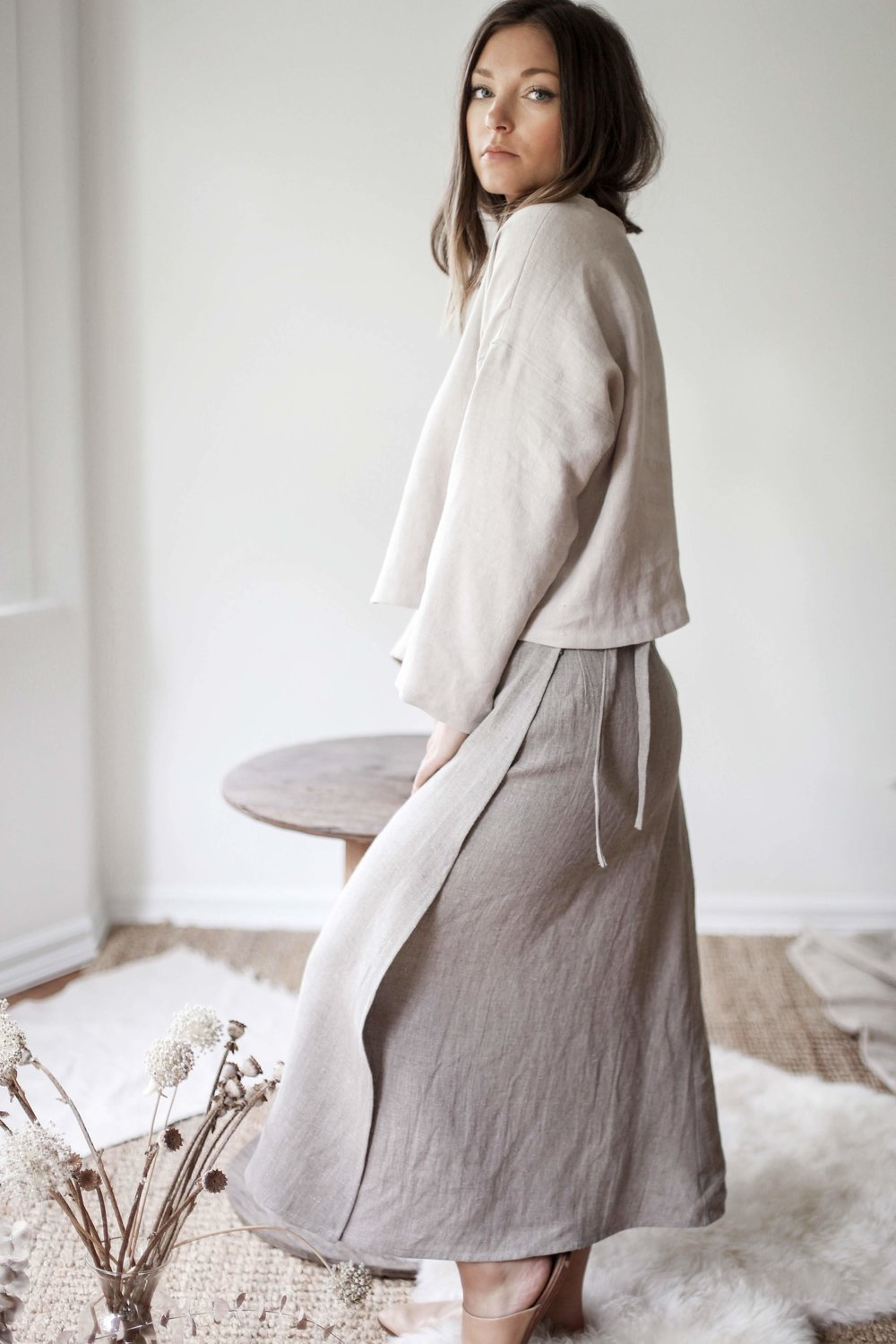 nomi-designs_madison-long-sleeve-top_gleam_natural-linen-top_side-with-wrap-skirt.jpg
