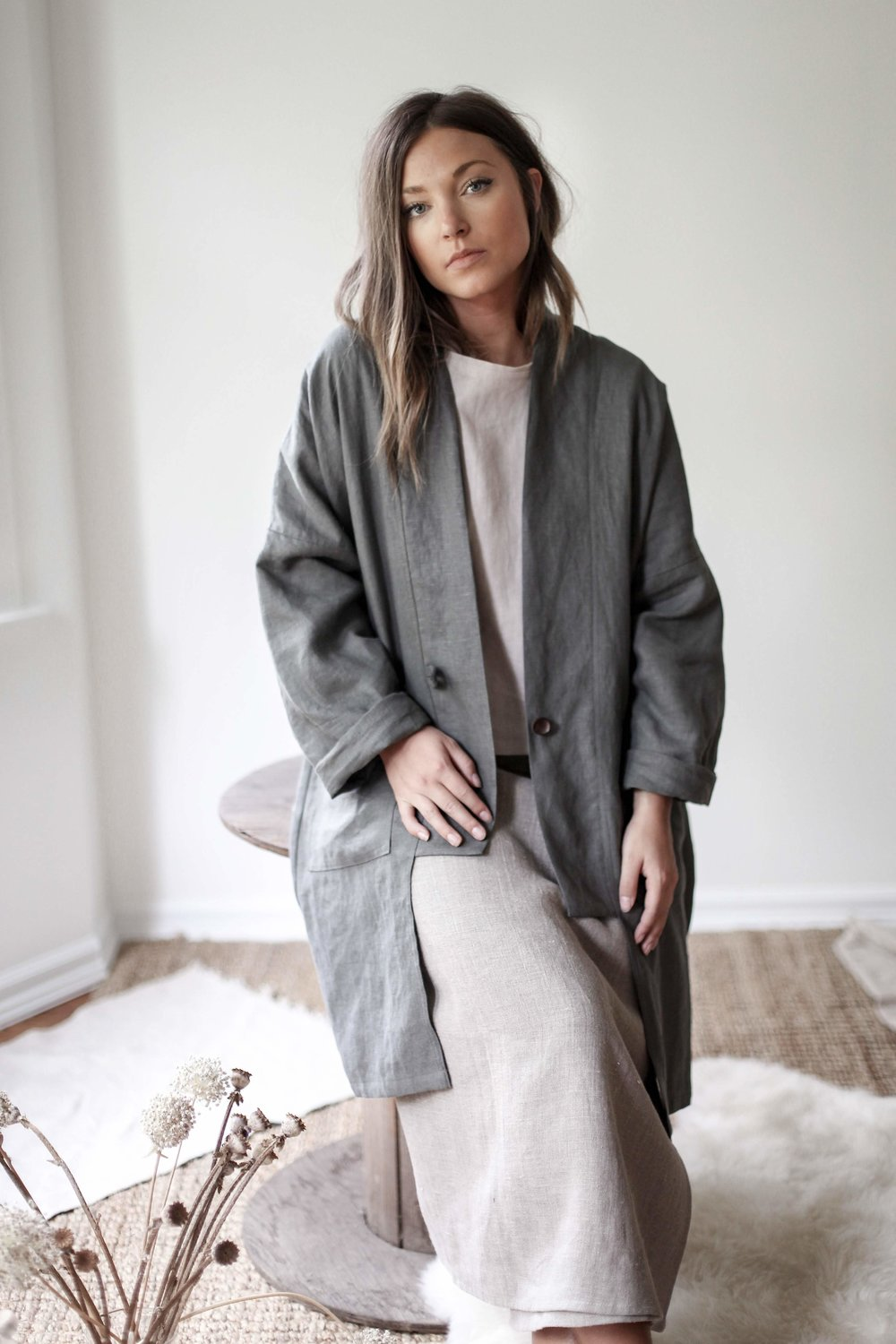 nomi-designs_kim-long-jacket_forest-colored_natural-linen-long-sleeve-jacket_front-styled.jpg