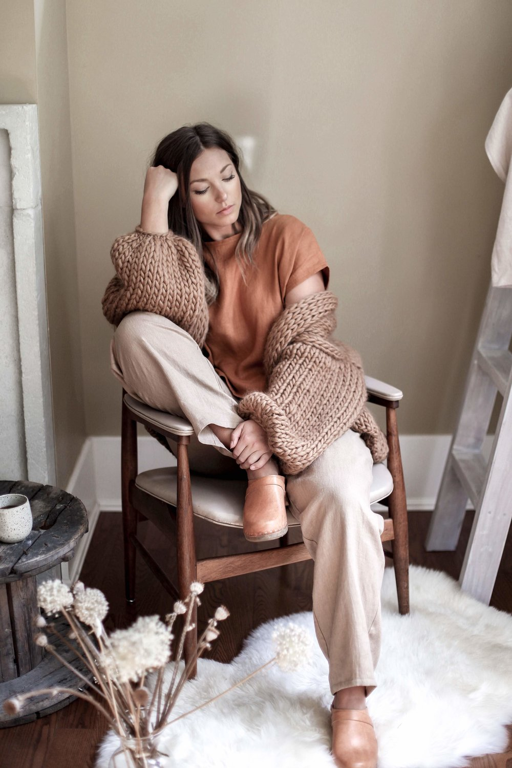 nomi-designs_jessie-top_rust-colored-natural-linen-short-sleeve-top_front_with-lyndsey-pants_styled-with-hendrik-lou-sweater.jpg