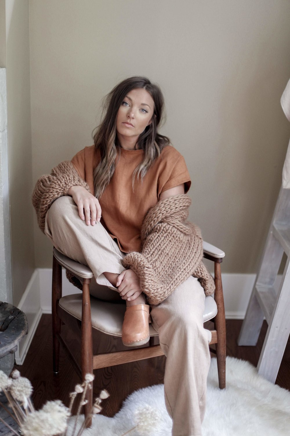 nomi-designs_jessie-top_rust-colored-natural-linen-short-sleeve-top_front_paired-with-lyndsey-pants_styled-with-hendrik-lou-sweater.jpg