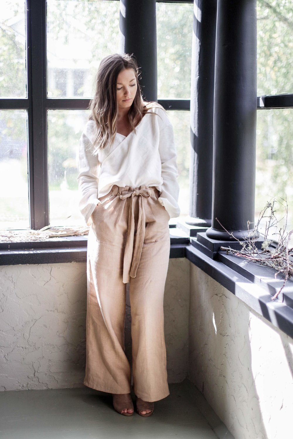 nomi-designs_maya-pants_camel-colored_natural-linen-pants-with-pockets-and-tie_styled-with-white-linen-top.jpg