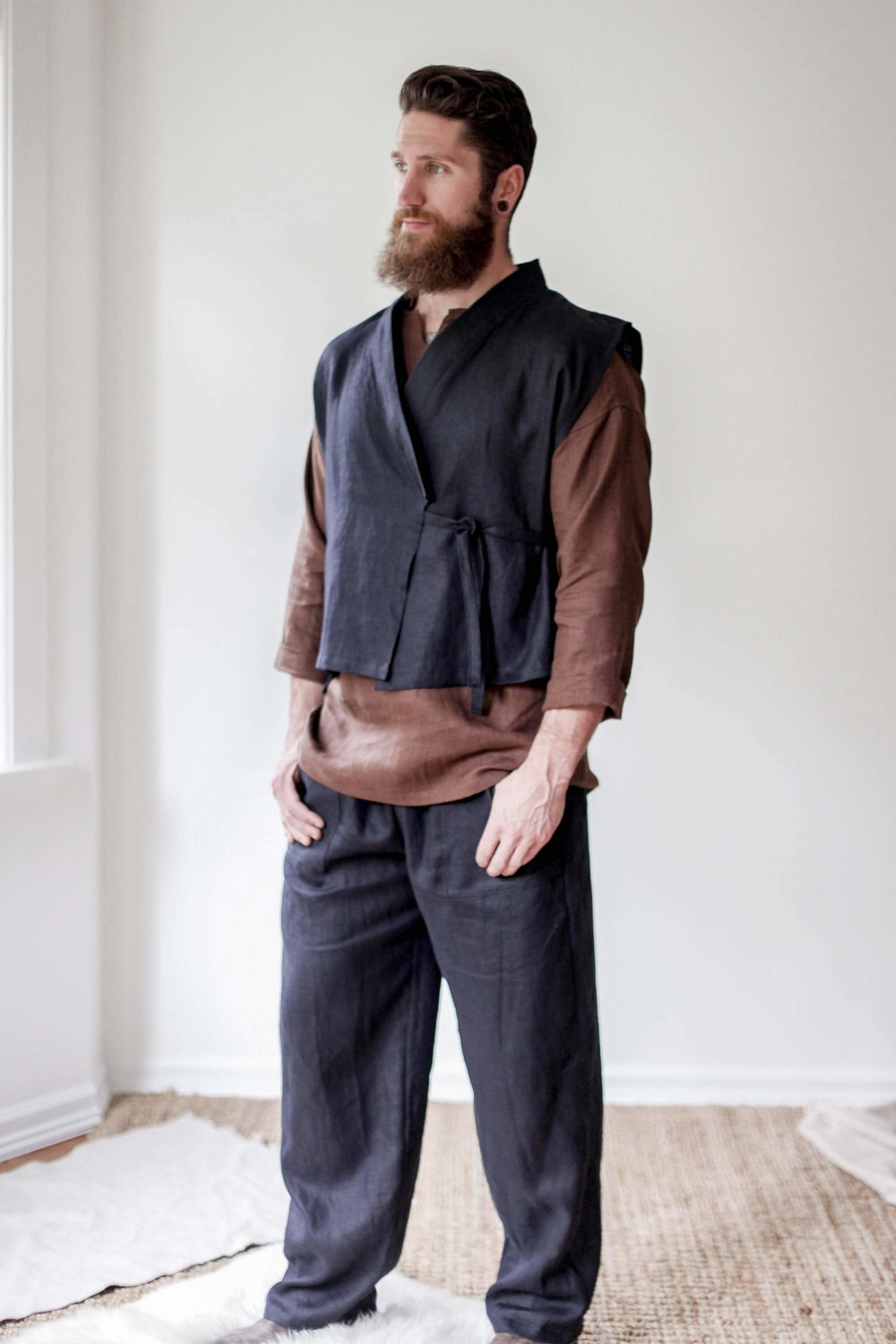 nomi-designs_mens-katara-vest_black_natural-linen-vest-for-men_front-paired-with-black-linen-pants.jpg