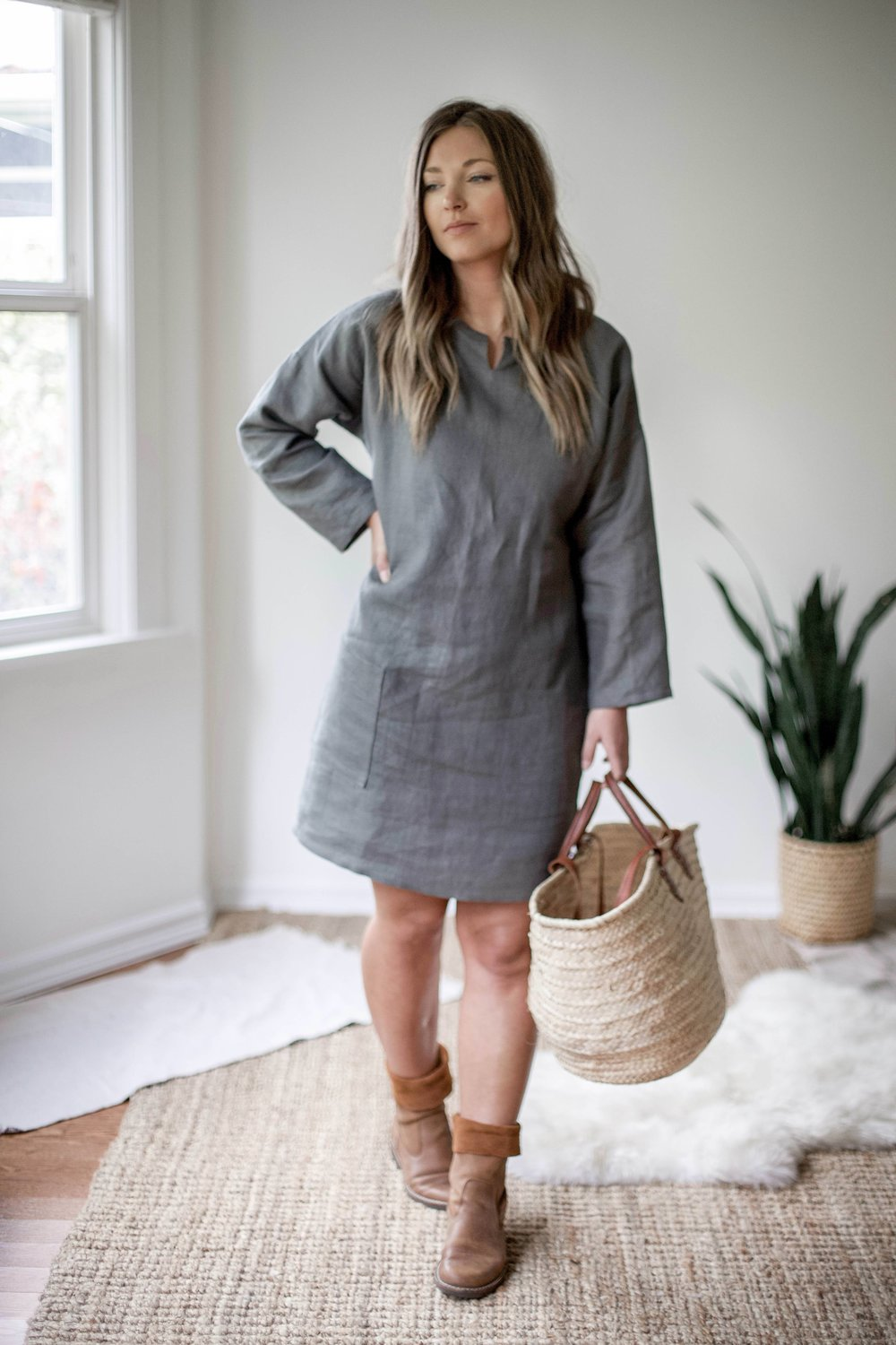 nomi-designs_ali-dress_forest-colored-natural-linen-dress-with-pockets_front-styled-with-boots-and-market-bag copy.jpg