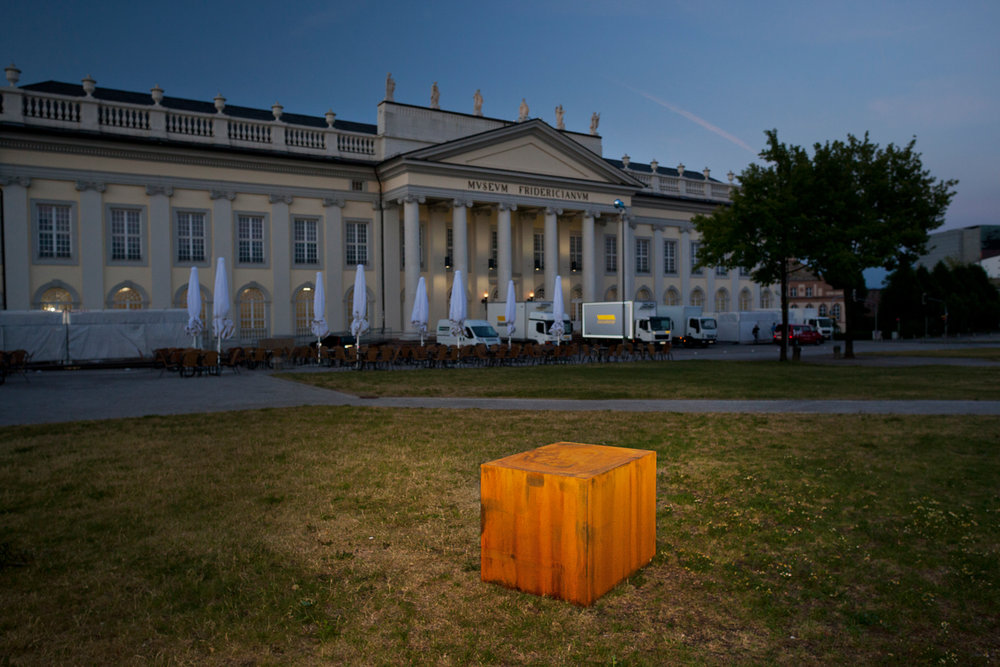 Argentinian artists Guillermo Faivovich & Nicolas Goldberg intended to bring the second-largest meteorite on Earth, named El Chaco from Argentina to Kassel for dOCUMENTA(13). However, due to the resistance of indigenous people who live near the meteorite, they placed a cube weighing more than 3 tons on Friedrichsplatz and documented their efforts.  Kassel, Germany