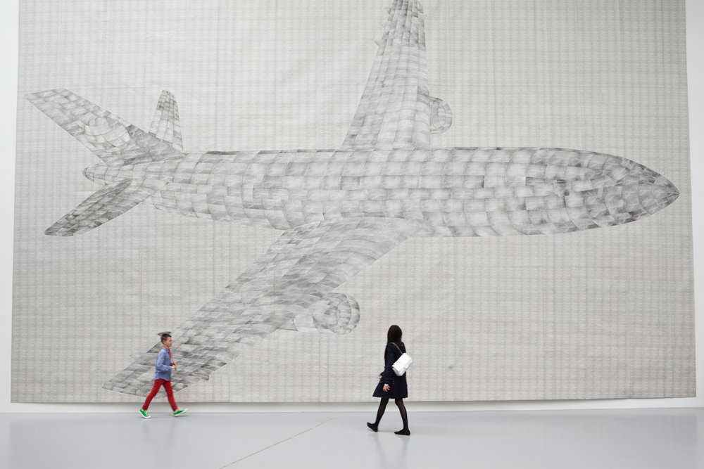 German artist Thomas Bayrle's work is amongst the most impressive at dOCUMENTA(13). His huge collage made of thousand of photos depicts an airplane, but is surrounded by technical apparatuses such as car engines or windshield wipers in constant motion.  Kassel, Germany