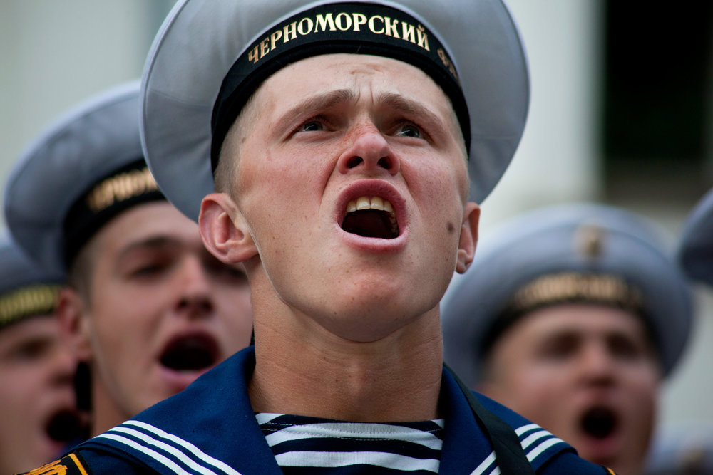 Side by side, Russian and Ukrainian Navy troops rehearse the anthem for the May 9th Victory Day parade, which marks the anniversary of the Soviet Unions victory over Nazi Germany in WWII.  Sevastopol, Crimea