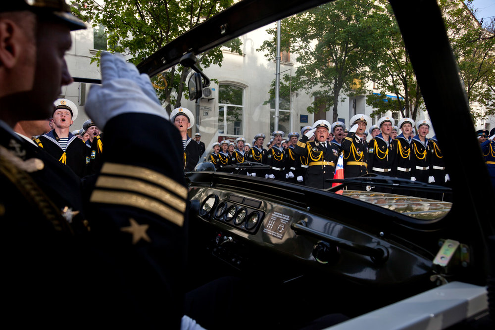 With equal parts panache and precision, Ukrainian sailors salute admirals of both fleets at a rehearsal for the May 9th Victory Day parade in Sevastopol, where both Russian and Ukrainian navies are anchored side by side.  Sevastopol, Crimea